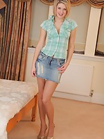 The lovely Ruby teases in her denim miniskirt and gold heels.